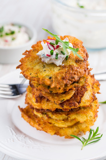 Fried potato  pancake with radishes cream cheese and chives. Vegetarian food concept