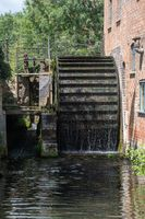 Large Watermill wheel working in the stream