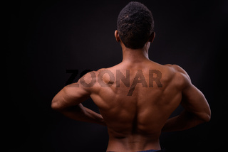 Portrait of young handsome muscular African man shirtless