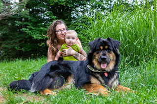 Mom, baby and dog in outdoor portrait
