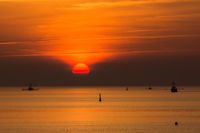 Silhouette of fishing trawlers at sunset, Buesum, Schleswig-Holstein, Germany
