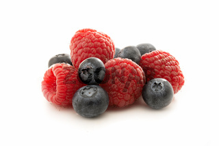 Raspberries and blueberries isolated