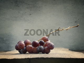 Fresh organic grapes on a wooden table