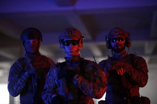 soldier squad team portrait in urban environment colored lightis