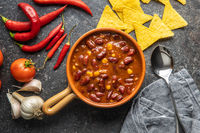 Chili con carne. Mexican food with beans in pot