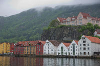 Old hansaetic wooden houses built in row at wharf of Bergen fjord are UNESCO World Heritage