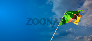 Beautiful national state flag of Zambia with blank space. Zambia flag on wide background with place for text 3D artwork.