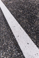 Old asphalt road with separation line. Selective focus.
