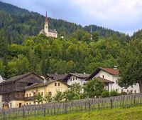 country village with the church St. Ulrich on the hill