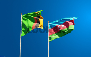 Beautiful national state flags of Zambia and Azerbaijan together at the sky background. 3D artwork concept.