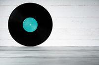 Vinyl record on white wooden background