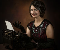 Young secretary with typewriter 1920s years