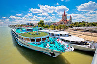 Vienna. Franz von Assisi church and river cruiser on Danube river in Vienna view