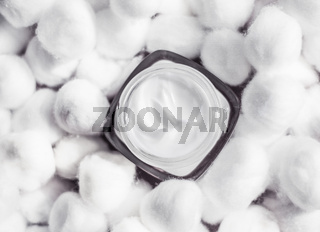 Luxury face cream for sensitive skin and white cotton balls on background, spa cosmetics and natural skincare beauty brand product
