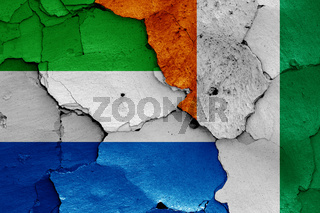 flags of Sierra Leone and Ivory Coast painted on cracked wall