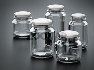 Empty glass jars with white lids isolated on black background. 3D illustration