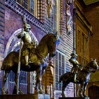 Illuminated herald statues on horse, east entrance of Bremen town hall, light art in the city 2020