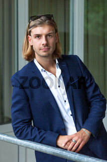 Portrait of young handsome stylish man. Outdoor fashion portrait.