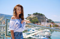 Woman pose on Denia castle and marina background. Spain