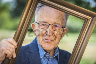 Look through a picture frame of pensioner