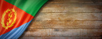 Eritrean flag on vintage wood wall banner
