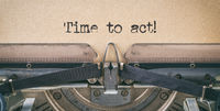 Text written with a vintage typewriter - Time to act