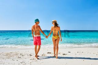 Couple walking on a tropical beach