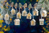 Christmas garland of lights in the form of white houses.