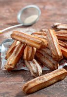 Traditional churros sprinkled with sugar and cinnamon.