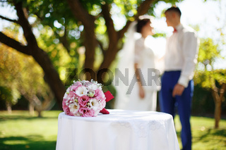 Wedding bridal bouquet with pink and white flowers on the table