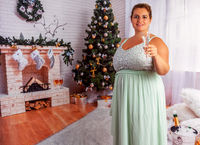 Elegant, overweight woman with a glass of champagne.