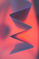 Folded backlit paper abstract accordion shape suitabe as wallpaper.