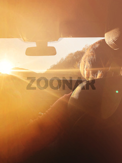 Woman in car during sunset