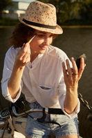 biker applies cosmetics