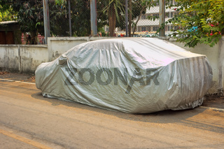 Storage of car under protective cover.