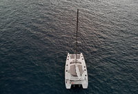 View from above drone point of view of white luxury catamaran in calm water of Atlantic Ocean, Tenerife, Canary Islands Spain