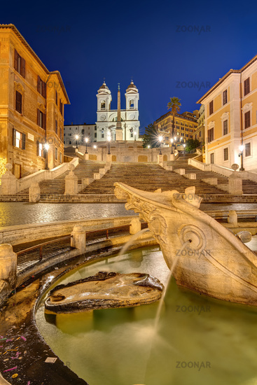 The famous Spanish Steps with a fountain in Rome at night