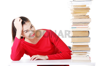 Attractive young woman with stack of books.
