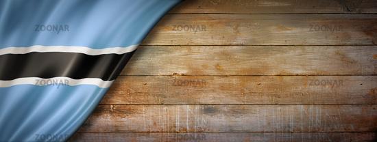 Botswana flag on vintage wood wall banner
