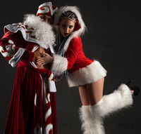 Sexy Snow Maiden flirting with Santa Clause