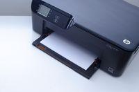 Calgary, Alberta, Canada. Nov. 19, 2020. An HP Deskjet 3522 e-All-in-One Printer on a white table..