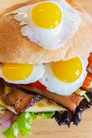 Delicious sandwich of quail eggs and vegetables