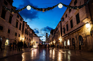 DUBROVNIK, CROATIA - December 31 2015: Stradun old street decorated with Christmas lights and ornaments, shining in the romantic atmosphere.