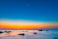 Sunset sea with rocks and sunset night