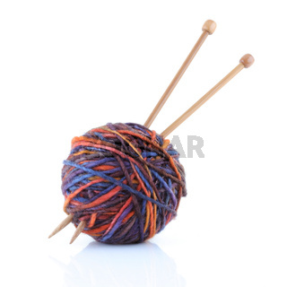 Ball of wool yarn with knitting needles