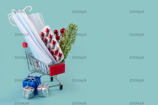 Christmas medical card with masks, pills in a shopping cart, and gift boxes.