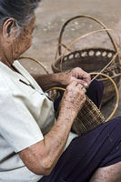 Skillful hands of a local woman weaving a basket, Ban Done Keo, Laos