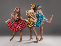 Show girls in pin-up dresses posing on camera