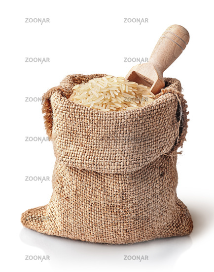 White rice and scoop in sack