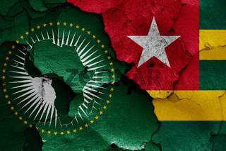 flags of African Union and Togo painted on cracked wall